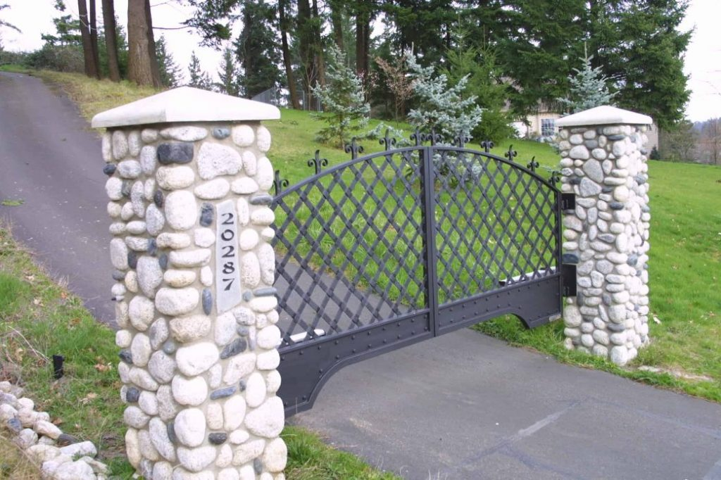 An automatic gate opening to the outside of the property